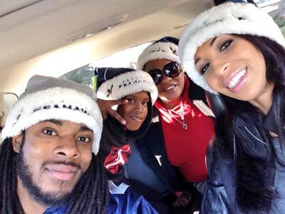 Ashley Moss with Richard Sherman Santa hats