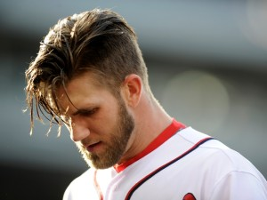 Washington Nationals' Bryce Harper comes off the field after he flied out during the seventh inning of an interleague baseball game, Thursday, May 9, 2013, in Washington. The Nationals won 5-4. (AP Photo/Nick Wass)